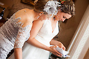 The Bride's mum gives a gift to her daughter on her wedding day.