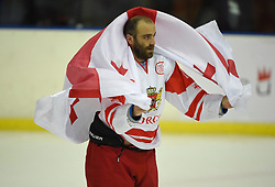 Cape Town 180420 Giorgia player Geperitdze Amiran covers himself with his national flag after their last game  in a Ice Hokey world championship against CHINA Taipei Grand West Casino.photograph:Phando Jikelo/African News Agency/ANA