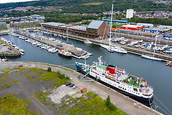 Aerial view of James Watt Dock Marina with Hebridean Princess ship in foreground,  in Greenock on River Clyde, Inverclyde, Scotland, UK