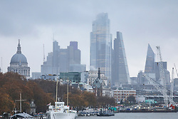 © Licensed to London News Pictures. 26/11/2019. London, UK. Mist and rain covers the City of London while Storm Sebastien continues to batter the South of England as the Met Office issue weather warnings for the South West.