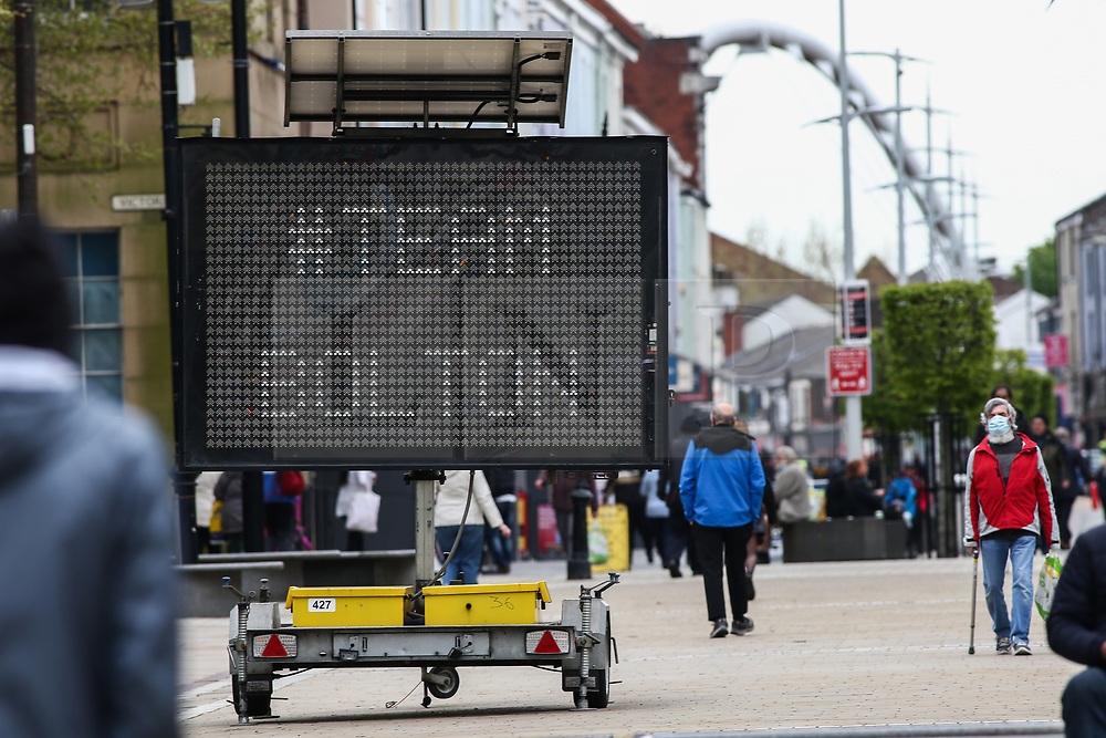 © Licensed to London News Pictures. 14/05/2021. Bolton, UK. Shoppers in Bolton town centre on Friday. Bolton now has the highest infection rate in Britain at 192.3 cases per 100,000. Photo credit: Adam Vaughan/LNP