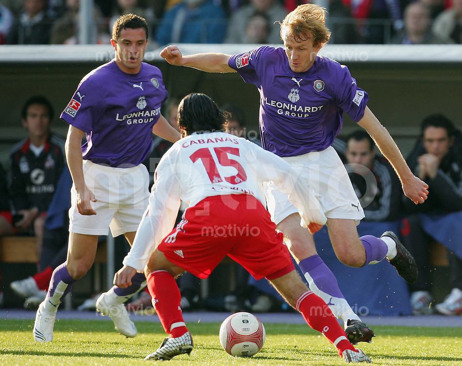 Fussball 2. Bundesliga FC Erzgebirge Aue - 1. FC Koeln Richard DOSTALEK r) und Dimitar RANGELOV (Aue, l) gegen Ricardo CABANAS (K).