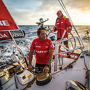 Leg 8 from Itajai to Newport, day 04 on board MAPFRE, Joan Vila contemplating the clouds, Rob Greenhalgh at the helm. 25 April, 2018.