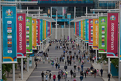 © Licensed to London News Pictures.  10/07/2021. London, UK. Members of the public walk through Olympic Way in Wembley Stadium ahead of the EURO 2020 final in London between England and Italy tomorrow evening (Sunday)  Photo credit: Marcin Nowak/LNP