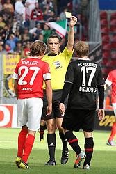 22.09.2012, Coface Arena, Mainz, GER, 1. FBL, 1. FSV Mainz 05 vs FC Augsburg, 4. Runde, im Bild Marcel De Jong (Augsburg) foult Nicolai Mueller (Mainz) gelbreif // during the German Bundesliga 4th round match between 1. FSV Mainz 05 and FC Augsburg at the Coface Arena, Mainz, Germany on 2012/09/22. EXPA Pictures © 2012, PhotoCredit: EXPA/ Eibner/ Bildpressehaus..***** ATTENTION - OUT OF GER *****