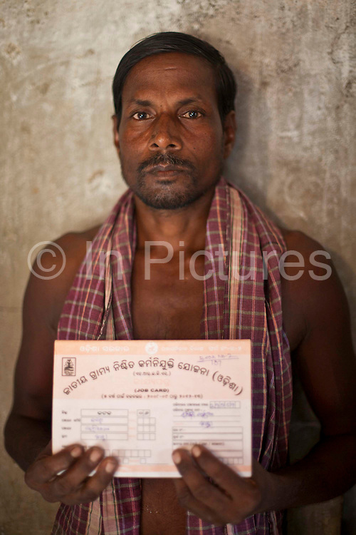 A Man with his government work permit organized by CLAP.  Committee for Legal Aid to Poor (CLAP) is a non-profit organisation helping to provide legal aid to the poorer communities in the Orissa district of India.