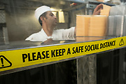 Social distancing sign still in place in this kebab shop as the national coronavirus lockdown three eases towards the planned Freedom Day on 22nd July 2021 in London, United Kingdom. Now that the roadmap for coming out of the national lockdown and easing of restrictions is set, dome medical professionals are suggesting thatsome safety measures are kept in place because of the increase in the Delta variant.