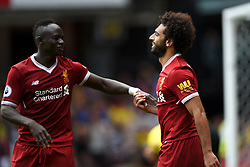 """Liverpool's Mohamed Salah (right) celebrates scoring his side's third goal with team-mate Sadio Mane during the Premier League match at Vicarage Road, Watford. PRESS ASSOCIATION Photo. Picture date: Saturday August 12, 2017. See PA story SOCCER Watford. Photo credit should read: Daniel Hambury/PA Wire. RESTRICTIONS: EDITORIAL USE ONLY No use with unauthorised audio, video, data, fixture lists, club/league logos or """"live"""" services. Online in-match use limited to 75 images, no video emulation. No use in betting, games or single club/league/player publications."""