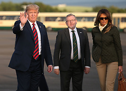 US President Donald Trump and his wife, Melania are welcomed by Scottish Secretary, David Mundell, as they arrive on Air Force One at Prestwick airport in Ayrshire, en route for Turnberry, where they are expected to stay over the weekend.