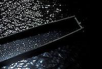 Detalle de curiara con agua dentro en rio, Estado Delta Amacuro, Venezuela.