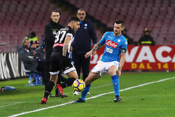 December 19, 2017 - Naples, Italy - CHRISTIAN MAGGIO (SSC Napoli) vies GIUSEPPE PEZZELLA (Udinese Calcio)..during the TIM Cup match between SSC Napoli and Udinese Calcio at Stadio San Paolo on December 19, 2017 in Naples, Italy. (Credit Image: © Paolo Manzo/NurPhoto via ZUMA Press)