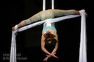 Teenage girl performs silks act high above July crowds at annual Peru Amateur Circus; Peru, Indiana.