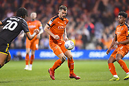 Luton Town player James Collins controls the ball on the sideline in the first half during the EFL Sky Bet League 1 match between Luton Town and AFC Wimbledon at Kenilworth Road, Luton, England on 23 April 2019.