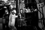 A contractor works on the deck of a drilling rig at a Devon Energy site in Center, Texas. Independent oil and gas producers that drill most of the wells in the United States have created the technology to extract natural gas from shale rock at an economic price, transforming the natural gas scene along with small communities in Texas and Louisiana.