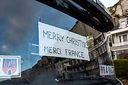 Message to France in truck windows as tensions are high for drivers who have been waiting over 48 hours for the Port of Dover to re-open, on the 23rd of December 2020, Dover, Kent, United Kingdom. The French border was closed due to a new strain of COVID-19 all travellers are now waiting to receive a COVID-19 test before they can board a ferry to Calais, France. Dover is the nearest port to France with just 34 kilometres 21 miles between them. It is one of the busiest ports in the world. As well as freight container ships it is also the main port for P&O and DFDS Seaways ferries.