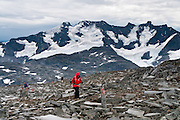 """In Jotunheimen National Park, Styggedalsbreen glacier flows from Store Styggedalstind (2387 meters or 7831 feet, in the Hurrungane Range), the fourth highest summit in Norway. For impressive views of """"the Home of the Giants,"""" walk 15 kilometers round trip through Helgedalen valley, with 1170 meters gain from Turtagrø Mountain Hotel to Fannaråken mountain (or Fannaråki, 2068-meters / 6785 feet elevation) in Luster municipality, Sogn og Fjordane county, Norway."""