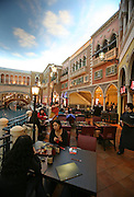 Customers sit at a restaurant at the Venetian casino's shopping mall in Macau, China, on February 24, 2008. The Venetian Macao-Resort-Hotel is a 163,000 square foot casino featuring 405 slots and 277 table games. Macao has overtaken Las Vegas with a gambling revenue of 7 billion U.S. dollars in 2006 (Las Vegas' was 6.6 billion U.S. dollars), and is now the world's top casino hut. Photo by Lucas Schifres/Pictobank