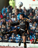 Photo: Ed Godden.<br />Reading v Wolverhampton Wanderers. Coca Cola Championship. 18/03/2006.<br />Reading's Ivar Ingimarsson (L) is challenged in the air by Jeremie Aliadiere.