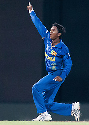 © Licensed to London News Pictures. 07/10/2012. Sri lankan Akila Dananjaya celebrates after getting a wicket during the World T20 Cricket Mens Final match between Sri Lanka Vs West Indies at the R Premadasa International Cricket Stadium, Colombo. Photo credit : Asanka Brendon Ratnayake/LNP
