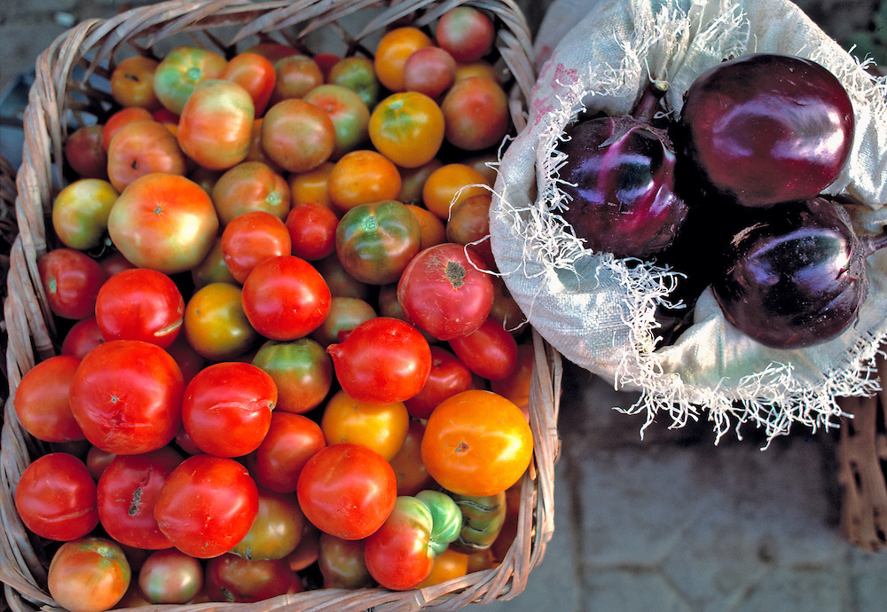 Tomatoes and eggplants create a colorful display at the market in Dunhuang, China.
