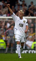 Photo. Glyn Thomas.<br /> Digitalsport<br /> NORWAY ONLY<br /> <br /> Leeds United v Charlton Athletic. <br /> FA Barclaycard Premiership. 08/05/2004.<br /> Leeds' Alan Smith celebrates scoring in his final home game for the side from a penalty, as beaten keeper Dean Kiely (L) looks on.