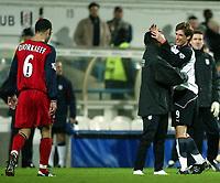 Photo. Aidan Ellis.<br />Fulham v Bolton Wanderers.<br />FA Barclaycard Premiership.<br />6/12/2003.<br />Fulham's Facundo Sava and Louis Saha celebrate the victory as  Bolton's Youri Djorkaeff trudges off