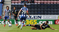 Wigan Athletic's Luke Burke is tackled by Blackburn Rovers' Ben Marshall<br /> <br /> Photographer David Shipman/CameraSport<br /> <br /> Football - The EFL Sky Bet Championship - Wigan Athletic v Blackburn Rovers - Saturday 13th August 2016 - DW Stadium - Wigan<br /> <br /> World Copyright © 2016 CameraSport. All rights reserved. 43 Linden Ave. Countesthorpe. Leicester. England. LE8 5PG - Tel: +44 (0) 116 277 4147 - admin@camerasport.com - www.camerasport.com