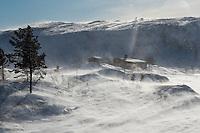 Mountain cabin in snow storm