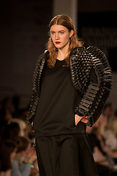 © Licensed to London News Pictures. 05/06/2016. London, UK. A model presents a look by Samuel Kaiser, from the University of East London. Graduate Fashion Week opens at the Old Truman Brewery in East London showcasing the work of over 1,000 of the very best graduates from over 40 universities around the world.  30,000 guests are expected to attend the annual event which features 22 catwalk shows and more. Photo credit : Stephen Chung/LNP