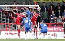 Peterborough United's Robert Olejnik clears the ball from Crawley Town's Kyle McFadzean - Photo mandatory by-line: Joe Dent/JMP - Tel: Mobile: 07966 386802 01/03/2014 - SPORT - FOOTBALL - Crawley - Broadfield Stadium - Crawley Town v Peterborough United - Sky Bet League One