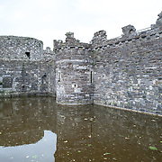 The moat of Beaumaris Castle on the island of Anglesey of the north coast of Wales, UK.