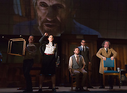 "© Licensed to London News Pictures. 08/05/2014. London, England. L-R: Christopher Patrick Nolan as Martin, Hara Yannas as Julia, Sam Crane as Winston; Tim Dutton as O'Brien and Stephen Fewell as Charrington.The Play ""1984"" by George Orwell transfers to the Playhouse Theatre until 19 July 2014. A new adaptation for the stage by Robert Icke and Duncan MacMillan. With Sam Crane as Winston Smith. Photo credit: Bettina Strenske/LNP"