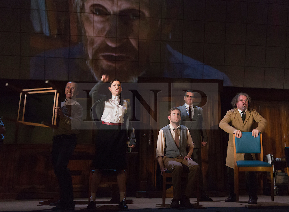"""© Licensed to London News Pictures. 08/05/2014. London, England. L-R: Christopher Patrick Nolan as Martin, Hara Yannas as Julia, Sam Crane as Winston; Tim Dutton as O'Brien and Stephen Fewell as Charrington.The Play """"1984"""" by George Orwell transfers to the Playhouse Theatre until 19 July 2014. A new adaptation for the stage by Robert Icke and Duncan MacMillan. With Sam Crane as Winston Smith. Photo credit: Bettina Strenske/LNP"""