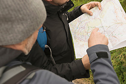 Two mature hikers checking the map for the right way, Austrian Alps, Carinthia, Austria