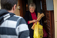 Berdaitz, a volunteer member of the Donostia Helping Network, speaks with Maria Angeles who who is confinated at home as she belongs to the risk group. Donostia (Basque Country). April3, 2020. (Gari Garaialde / Bostok Photo)