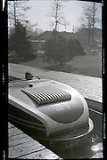 boy in bumper boat car 1950s USA amusement park