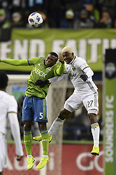 November 8, 2018 - Seattle, Washington, U.S - Seattle's NOUHOU (5) and Portland's DAIRON ASPRILLA (27) go up for a ball as the Portland Timbers visit the Seattle Sounders in a MLS Western Conference semi-final match at Century Link Field in Seattle, WA. (Credit Image: © Jeff Halstead/ZUMA Wire)