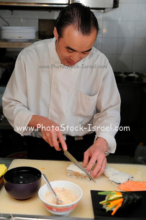 A Japanese cook preparing Sushi at a Japanese restaurant