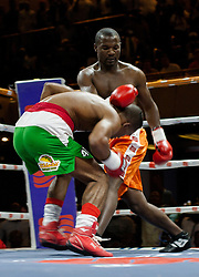 Zimbabwe boxer Charles Manyuchi throws a punch as Jose Agustine Feria of Colombia ducks in an international non title welterweight fight , the match ended in a TKO during the first round, October 15 2016. Photo/Jekesai Njikizana.