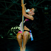 Former competitive dancer Krisztina Nemesvari cleaning the pole for next competitor's performance as a special show for the audience during the first Hungarian Pole Dance Championships organized by striptease world champion Alma Pirner. Erotic exhibition held in Hungexpo expo center. in Budapest, Hungary on September 06, 2008. ATTILA VOLGYI