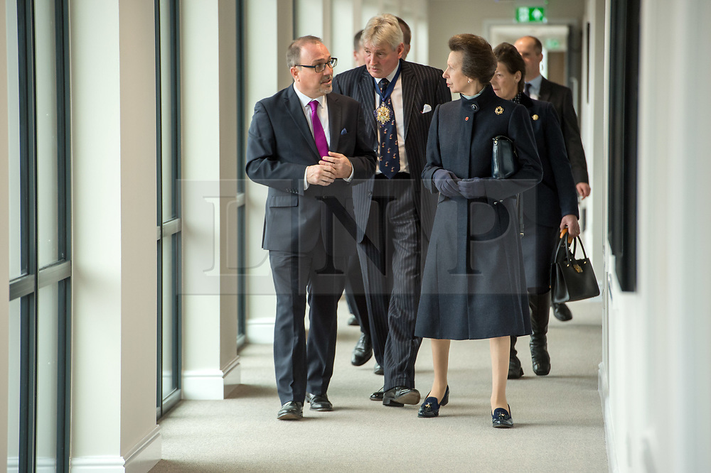 © Licensed to London News Pictures. 13/04/2018. Keynsham, Bath & North East Somerset, UK. Visit of Her Royal Highness, The Princess Royal, PRINCESS ANNE, to switch on a giant sun art installation marking the Grand Opening of the development of the Chocolate Quarter in Keynsham on the site of the former Frys and Cadburys Chocolate factory which closed in 2011. The art installation is a giant artificial sun that will glow between the iconic red-brick buildings, radiating warmth, light and sound for a sensory exploration that the public are invited to discover and walk beneath. The installation is seven metres high and six metres wide and symbolises a new dawn for the historic building which is now home to a vast intergenerational living complex of retirement homes, pizzeria, restaurant, spa and cinema. The Chocolate Quarter is home to 136 retirement apartments and Charterhouse, a 93-bed care home. Photo credit: Simon Chapman/LNP
