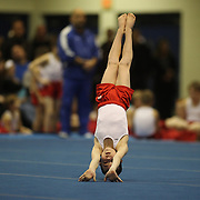 A young male gymnasts performs his floor routine during the 21st American Invitational 2014 competition at the XL Centre. Hartford, Connecticut, USA. USA. 31st January 2014. Photo Tim Clayton