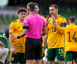 DUBLIN, REPUBLIC OF IRELAND - Sunday, October 11, 2020: Wales' captain Aaron Ramsey (R) and Daniel James (L) react to the referee's decision during the UEFA Nations League Group Stage League B Group 4 match between Republic of Ireland and Wales at the Aviva Stadium. The game ended in a 0-0 draw. (Pic by David Rawcliffe/Propaganda)