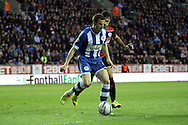 Wigan Athletic's Gary Caldwell holds off Queens Park Rangers Charlie Austin. Skybet football league championship play off semi final, 1st leg match, Wigan Athletic v QPR at the DW Stadium in Wigan, England on Friday 9th May 2014.<br /> pic by Chris Stading, Andrew Orchard sports photography.