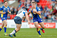 Featherstone Rovers prop Luke Cooper (17) tackles Doncaster RLFC loose forward Brandon Wilkinson (26)  during the Challenge Cup 2018 match between Doncaster and Featherstone Rovers at the Keepmoat Stadium, Doncaster, England on 22 April 2018. Picture by Simon Davies.