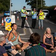 Morning yoga and meditation by the gates. 20-30 people slept on the road and are slowly waking up. Block Around the Clock - fourty eight hours of party, work shops, yoga, sleeping  and anti-fracking campaigning in front of the gates to Cuadrilla's fracking site in New Preston Road, Lancashire. The Cuadrilla site in Lancashire in a highly contested site, almost ready to extract gas. Block Around the Clock is part of a nationwide campaign to prevent fracking in Lancashire and across the England ( fracking is either banned or put on hold  in Scotland, Wales and Northern Ireland.) Block Around the Clock - fourty eight hours of party, work shops, yoga, sleeping  and anti-fracking campaigning in front of the gates to Cuadrilla's fracking site in New Preston Road, Lancashire. The Cuadrilla site in Lancashire in a highly contested site, almost ready to extract gas. Block Around the Clock is part of a nationwide campaign to prevent fracking in Lancashire and across the England ( fracking is either banned or put on hold  in Scotland, Wales and Northern Ireland.)