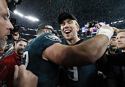 February 4, 2018 - Minneapolis, MN, USA - Philadelphia Eagles quarterback Nick Foles (9) joins teammates in celebrating their victory over the New England Patriots in Super Bowl LII on Sunday, February 4, 2017 at U.S. Bank Stadium in Minneapolis, Minn. (Credit Image: © Carlos Gonzalez/TNS via ZUMA Wire)
