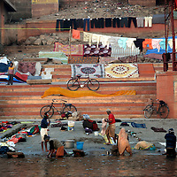 Asia, India, Varanasi. Laundry washed in the Ganges river and dried on the ghats at Varanasi.