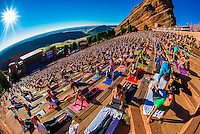 """Yoga on the Rocks""; 2000 people doing yoga together at Red Rocks Amphitheatre, Morrison (Denver), Colorado USA."