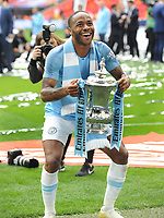 Football - 2019 Emirates FA Cup Final - Manchester City vs. Watford<br /> <br /> Manchester City's Raheem Sterling lifts the trophy, at Wembley Stadium.<br /> <br /> COLORSPORT/ANDREW COWIE